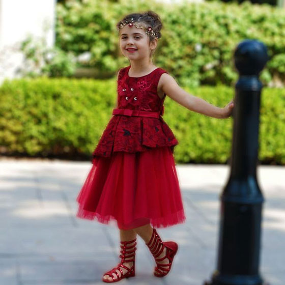a dark red peplum dress