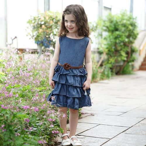 little girl wearing a denim dress