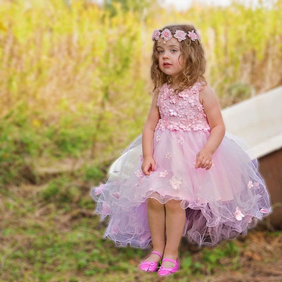 a young girl in a pink Easter dress