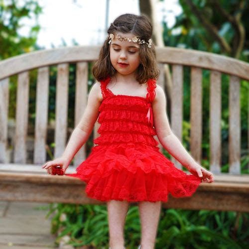 a red lace dress with a tiered skirt