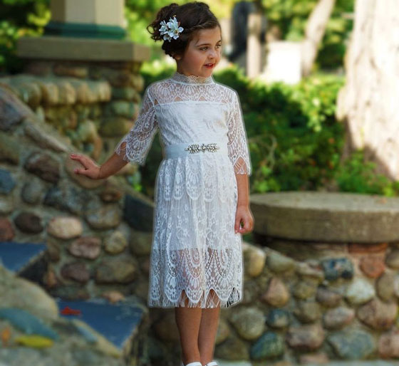 a white lace drop-waist dress with a belt