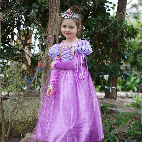 child in a Rapunzel costume