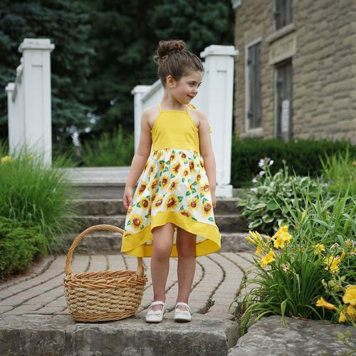 girl wearing a sunflower printed dress