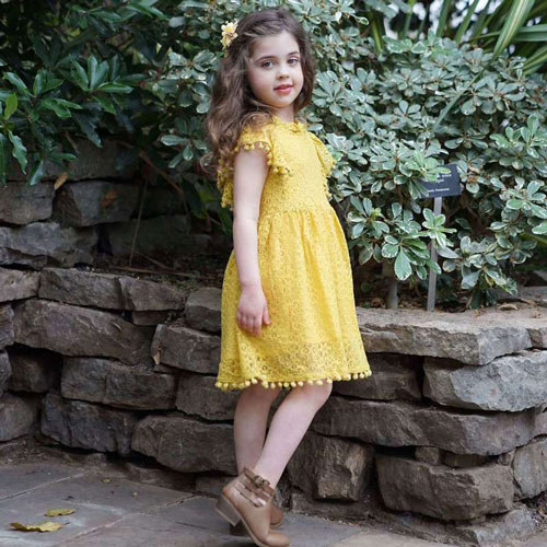 child wearing vintage-inspired yellow dress